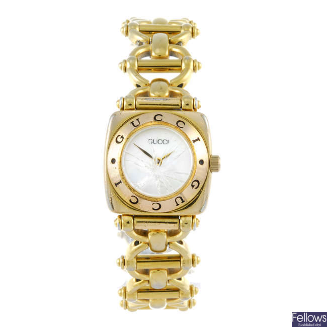 GUCCI - a lady's gold plated 6400L bracelet watch.