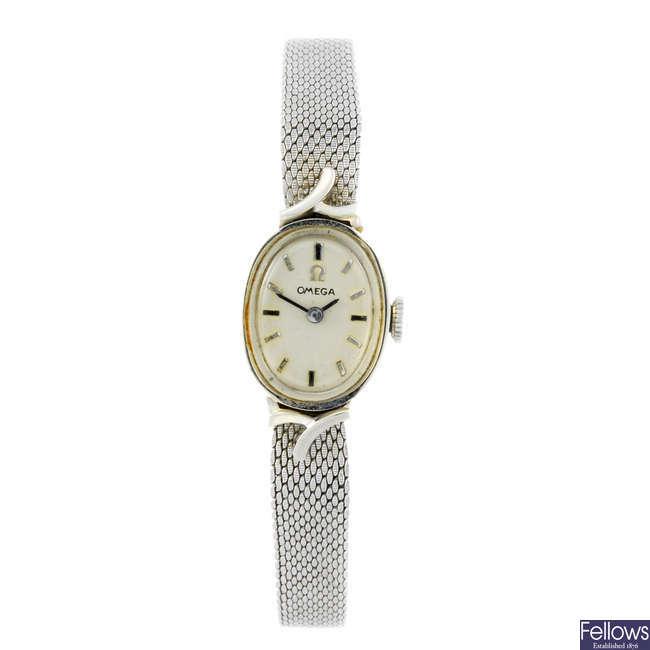 OMEGA - a lady's white metal bracelet watch.