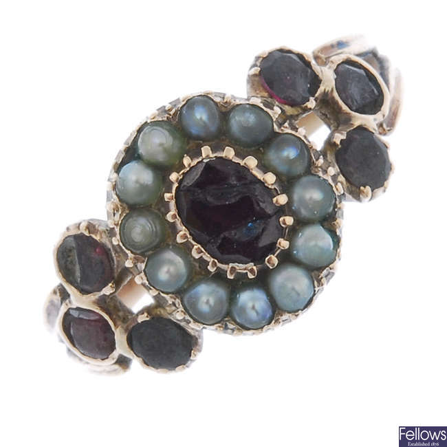 A mid 19th century gold garnet and split pearl ring.