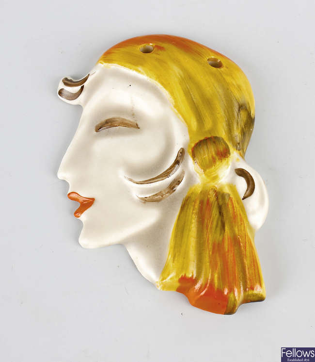 A rare early 1930s Clarice Cliff miniature wall mask.