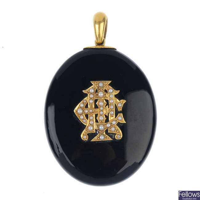 A late Victorian onyx and seed pearl memorial pendant.