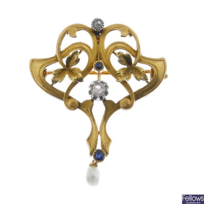 A French Art Nouveau 18ct gold and gem-set pendant.