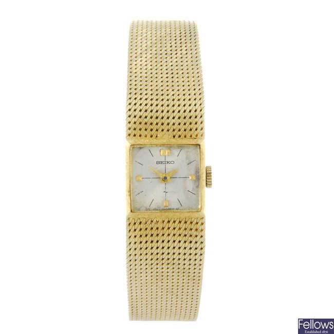 SEIKO - a lady's yellow metal  bracelet watch.