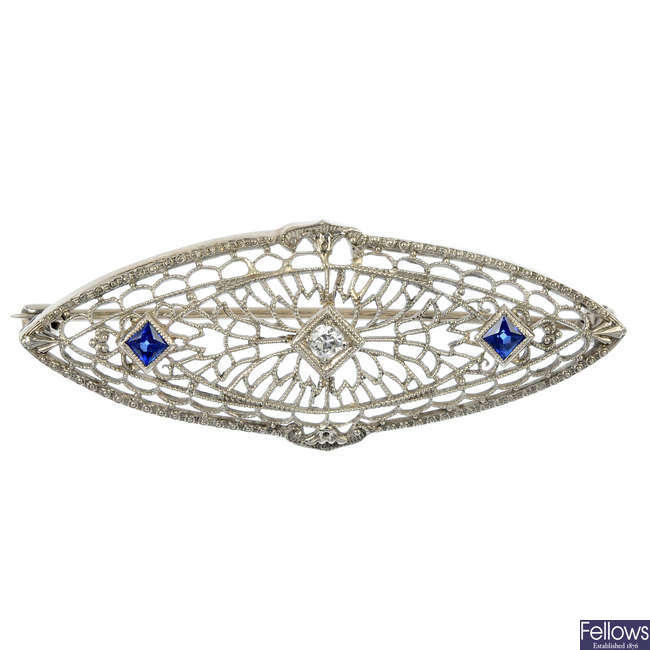 A diamond and synthetic sapphire brooch.