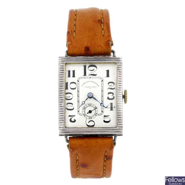 GOLDSMITHS & SILVERSMITHS CO. - a gentleman's white metal wrist watch.