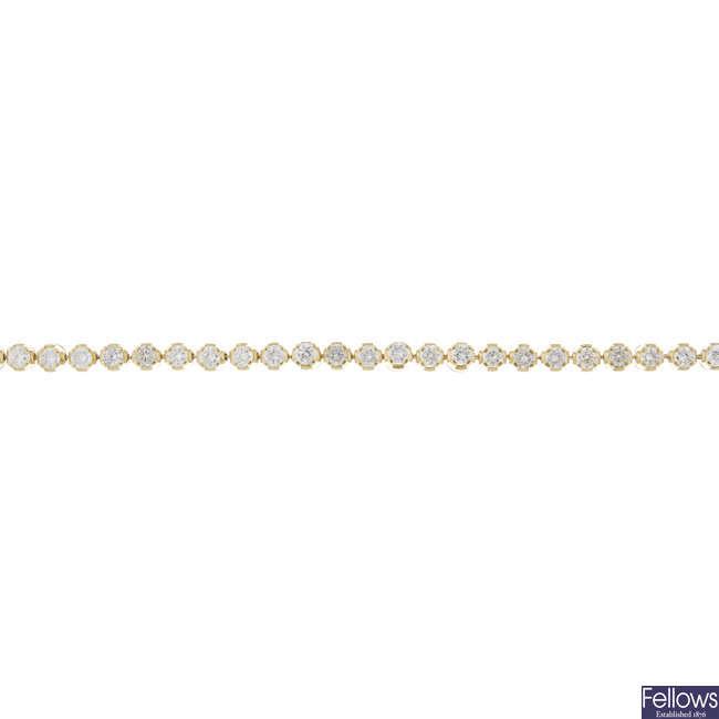 An 18ct gold diamond line bracelet.