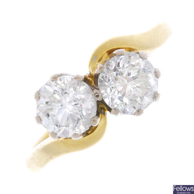 An 18ct gold diamond two-stone crossover ring.