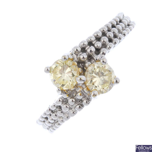 A 'yellow' diamond two-stone crossover ring.