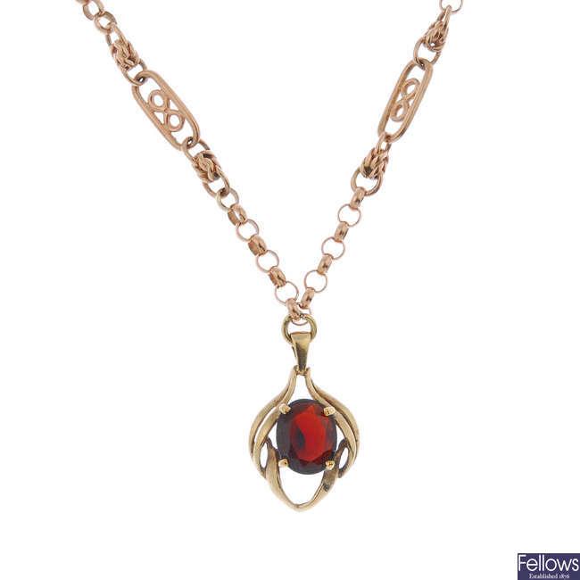 A 9ct gold garnet pendant.