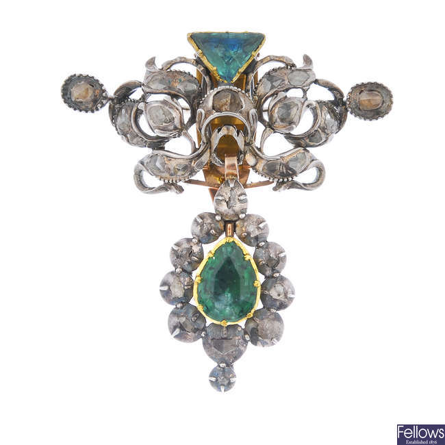 A late 19th century silver and gold emerald and diamond brooch.