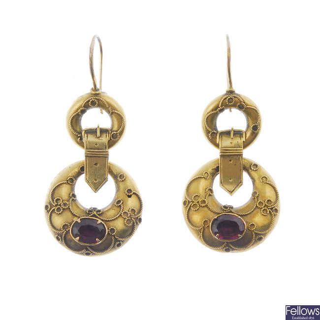 A pair of late Victorian gold garnet ear pendants.
