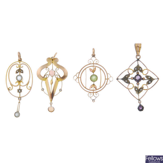 A selection of four early 20th century 9ct gold gem-set pendants.