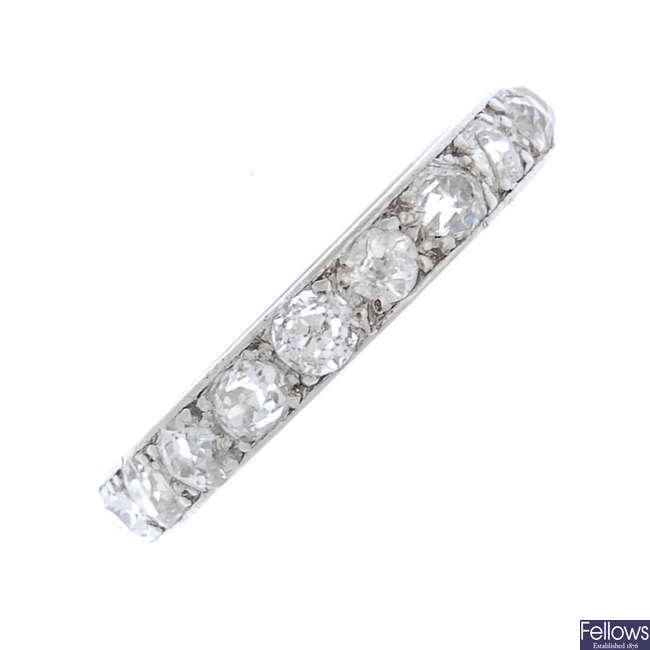 A mid 20th century platinum diamond full-circle eternity ring.