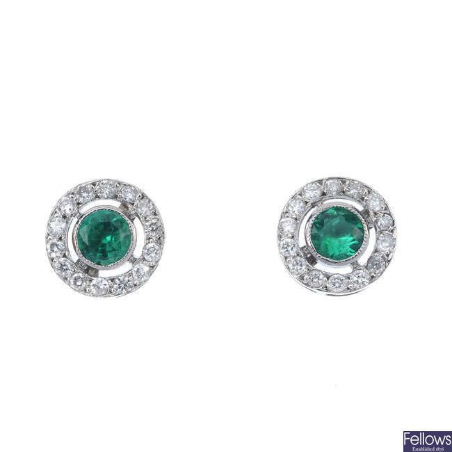 A pair of emerald and diamond ear studs.