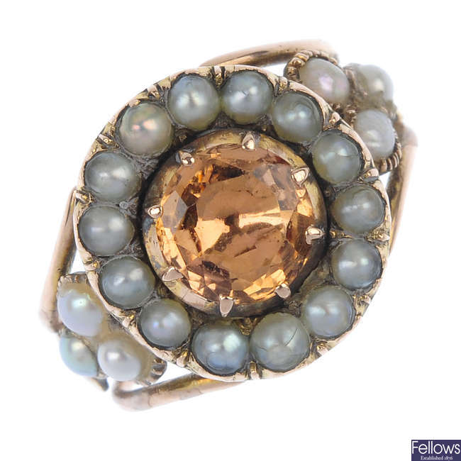 A late 19th century split pearl and gem ring.