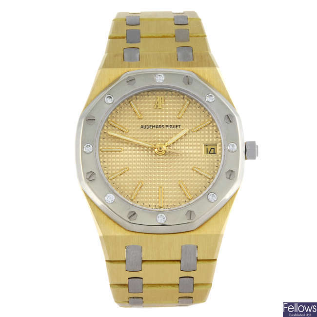 AUDEMARS PIGUET - a gentleman's yellow metal Royal Oak bracelet watch.