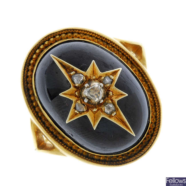 A mid 19th century gold garnet and diamond ring.