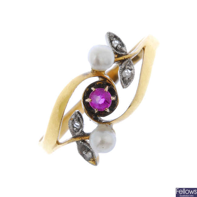 An early 20th century 18ct gold ruby, seed pearl and diamond floral dress ring.
