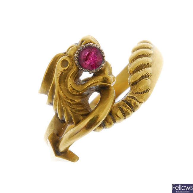 A garnet-topped-doublet novelty dress ring.