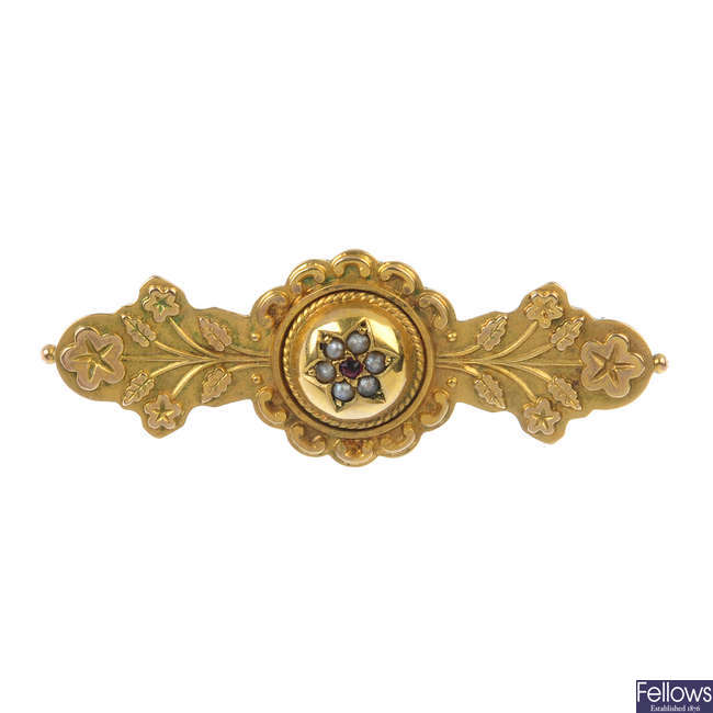 A late Victorian 9ct gold ruby and seed pearl brooch with memorial panel.