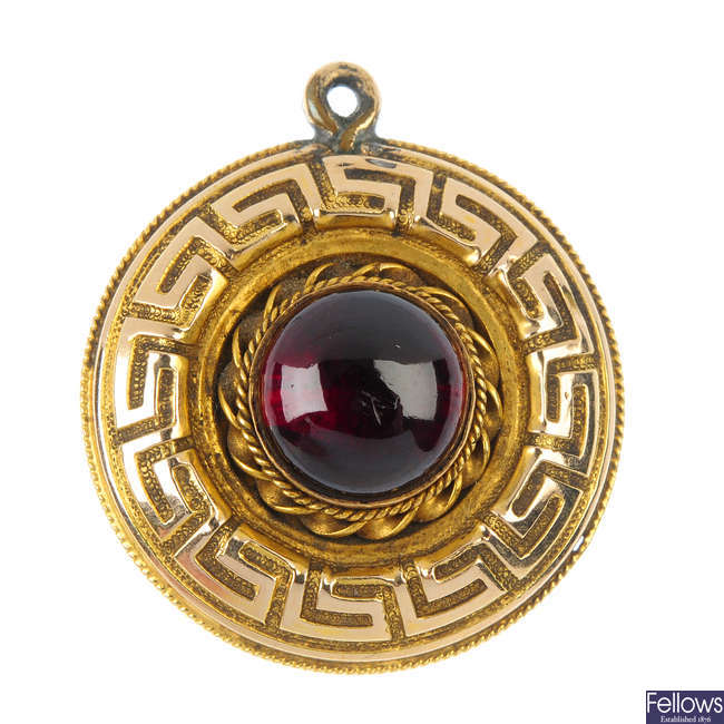 A late 19th century gold garnet memorial pendant.