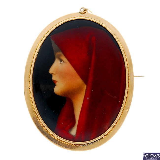A mid 20th century enamel portrait brooch.