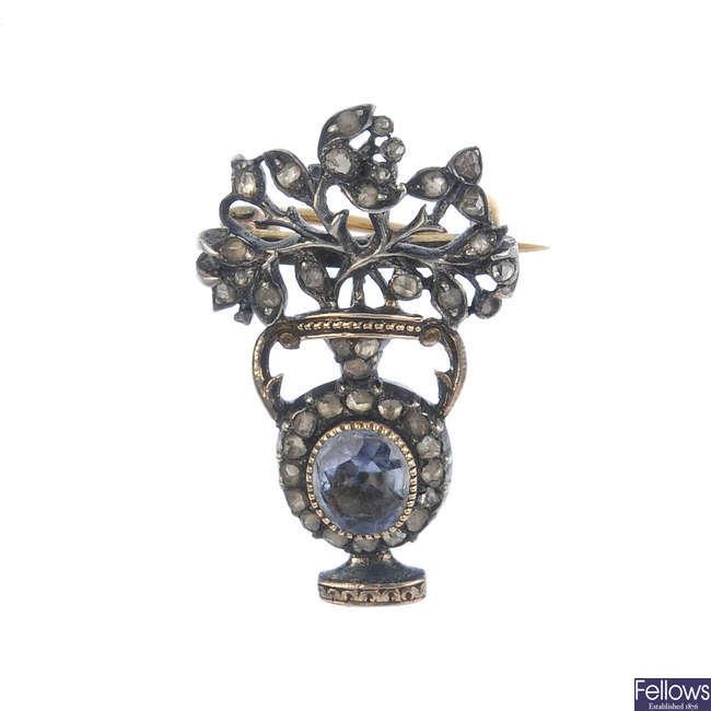 A mid 19th century silver gem-set brooch.