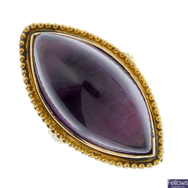 A George III 18ct gold memorial ring with replacement amethyst.