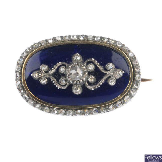 A mid Victorian enamel and diamond brooch.