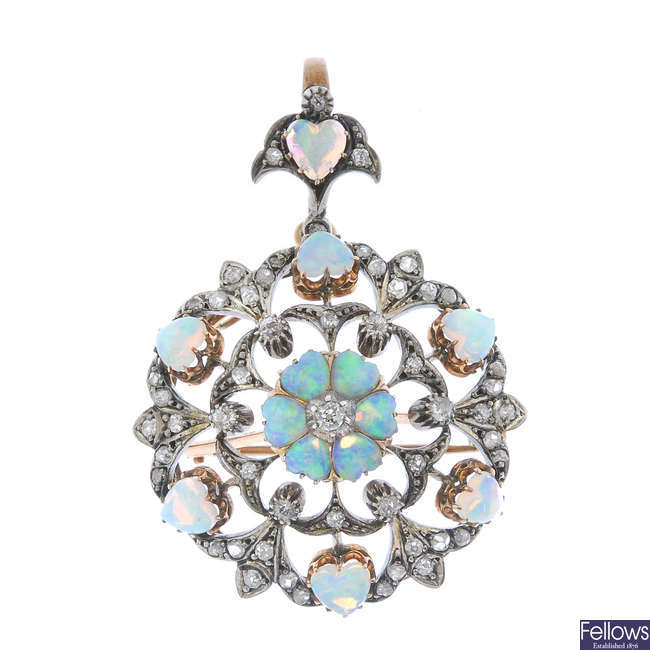A late 19th century silver and gold opal and diamond pendant.