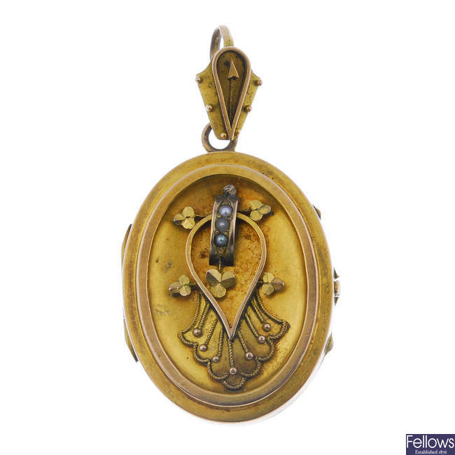A late 19th century gold and seed pearl locket, circa 1860.