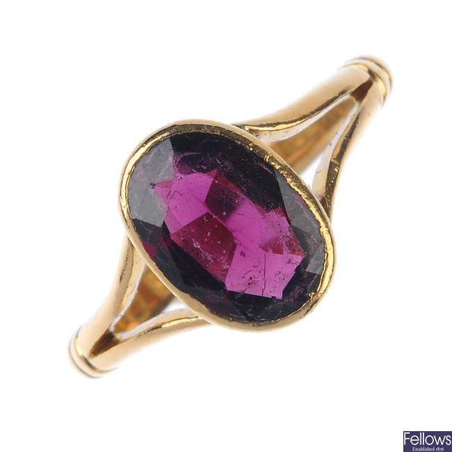A late Victorian 22ct gold garnet ring.