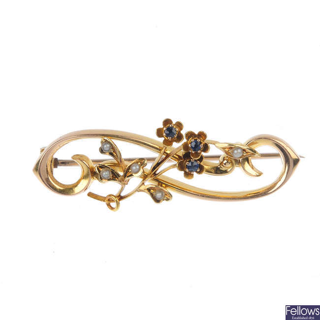 An Edwardian 15ct gold sapphire and split-pearl floral brooch.