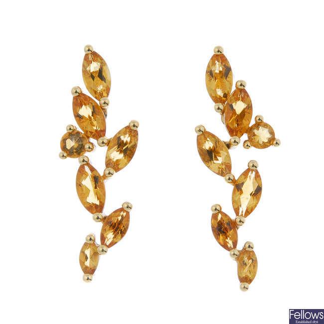 A pair of citrine ear pendants.
