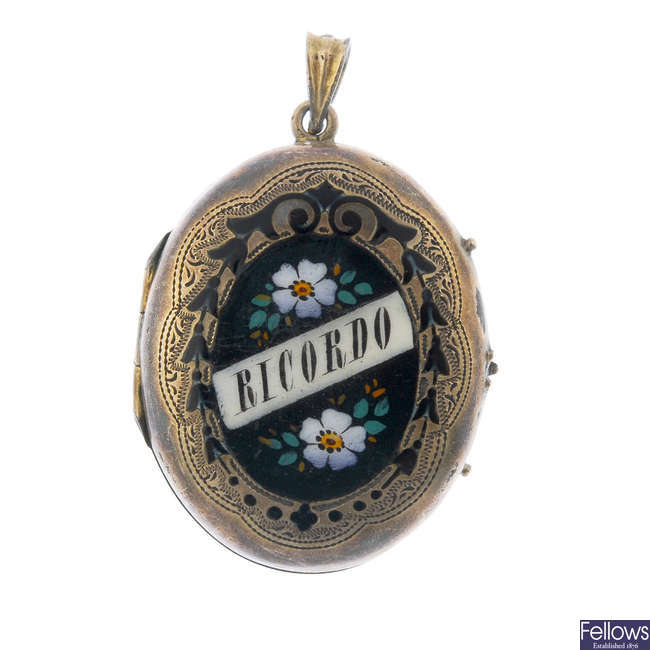 A late Victorian stickpin and enamel locket.