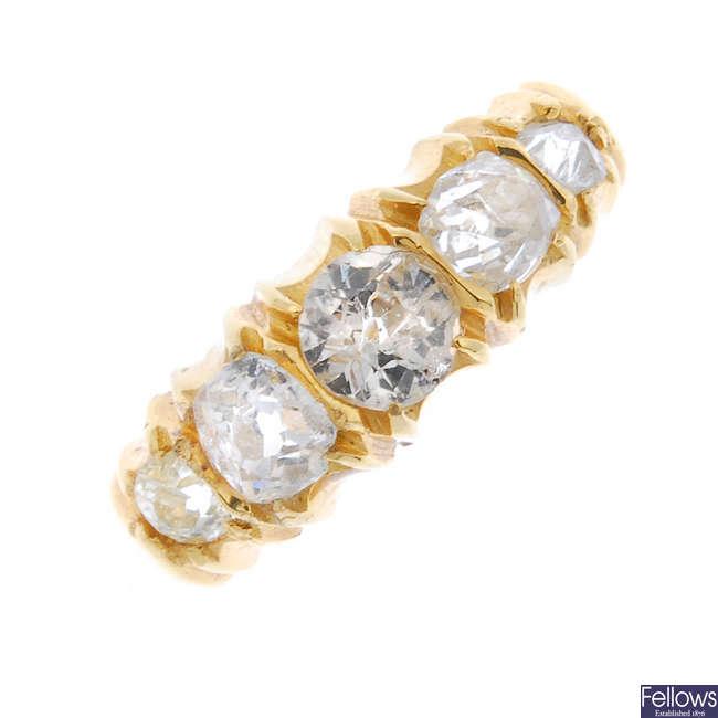 An Edwardian diamond five-stone ring.