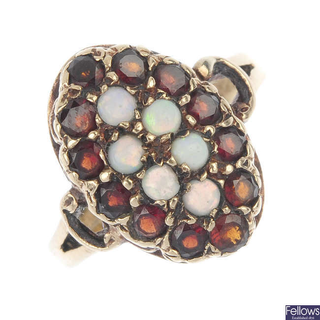 A 9ct gold opal and garnet cluster ring.