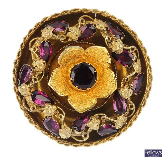 A mid 19th century gold garnet floral brooch.
