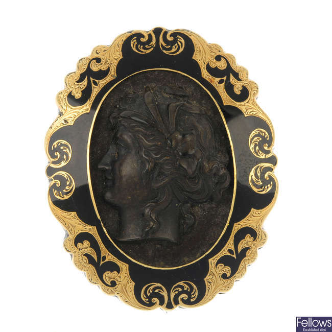 A late Victorian 15ct gold enamel mourning brooch.