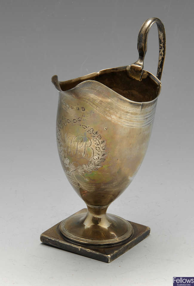 A George III silver cream jug, etc.
