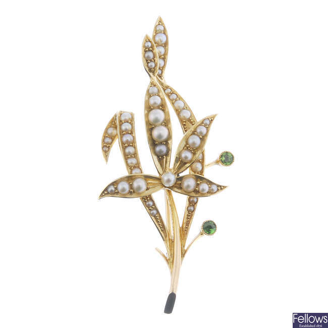 An early 20th century 15ct gold seed, split pearl and demantoid garnet brooch.