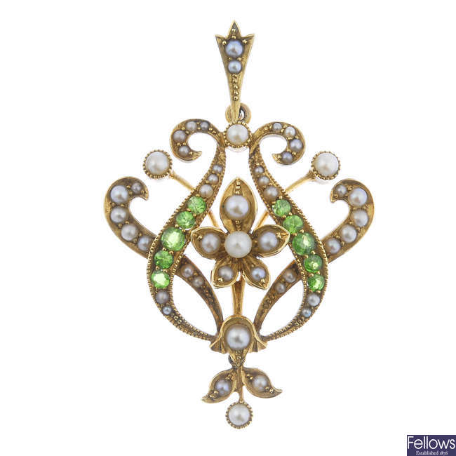 An early 20th century 15ct gold seed and split pearl and demantoid garnet pendant.