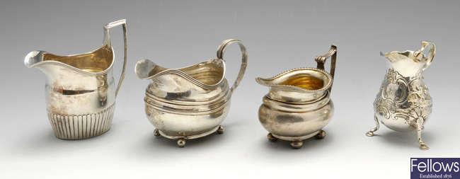 A George II silver cream jug, etc.