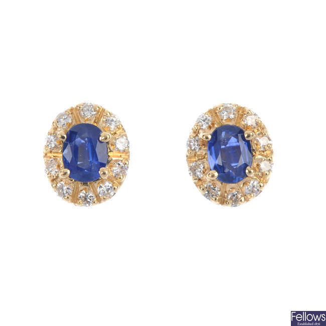 A pair of sapphire and diamond cluster ear studs.