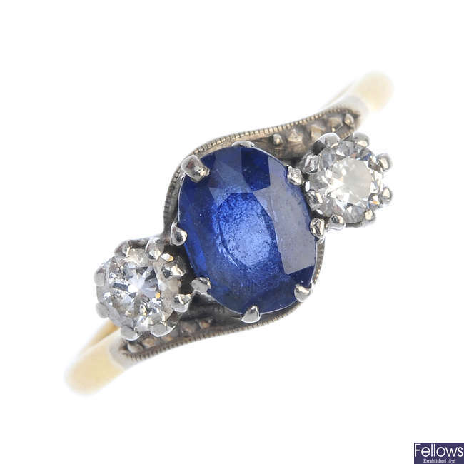 A mid 20th century 18ct gold sapphire and diamond three-stone ring.