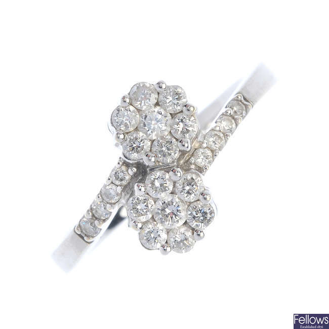 A diamond twin floral cluster ring.