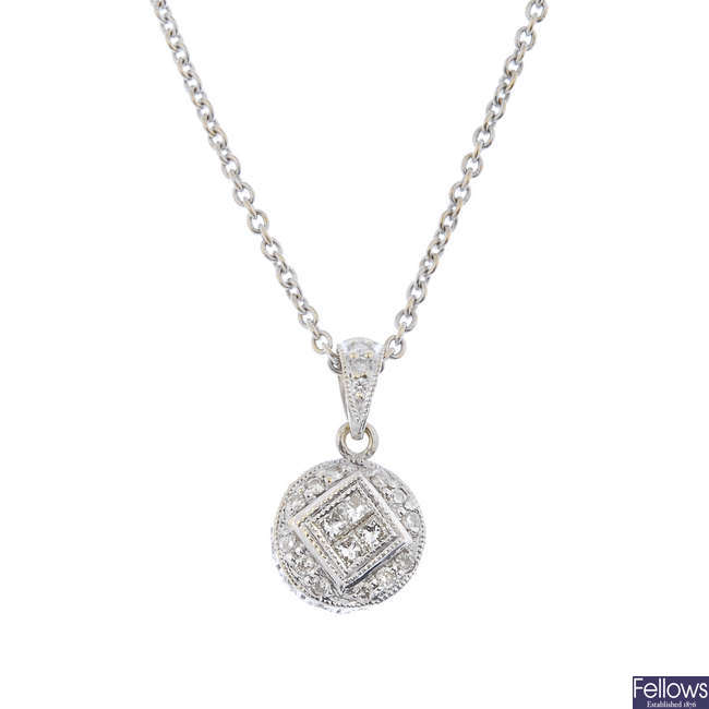 A diamond pendant and chain.