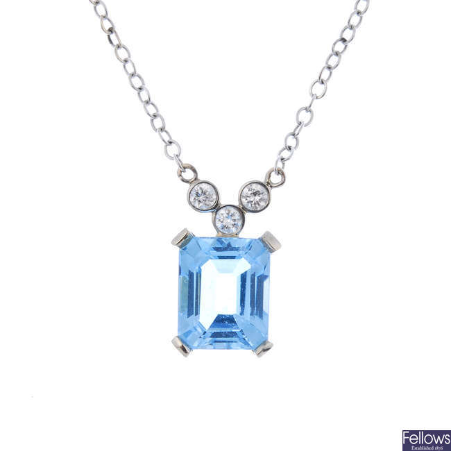 A topaz and diamond necklace.