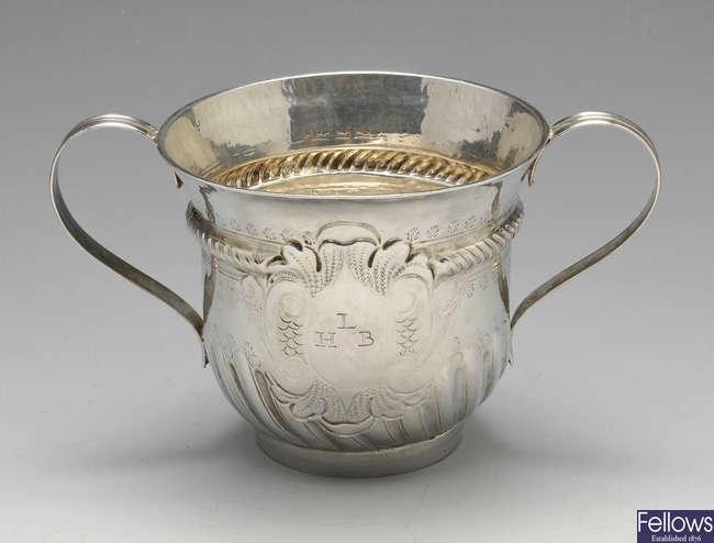 A Queen Anne silver porringer.