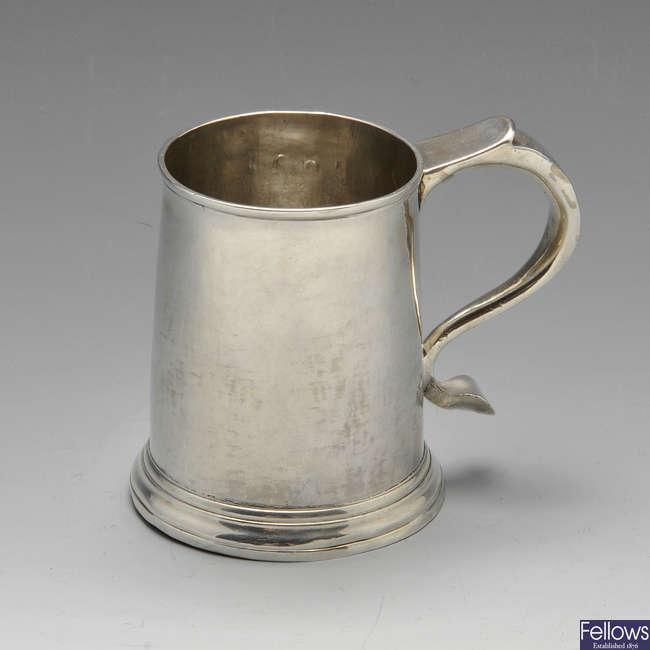 A George I silver half pint mug.